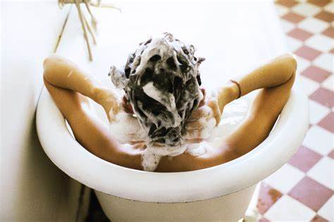 What is the purpose of using a scalp cleansing shampoo?